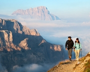 Couple hiking the Italian Dolomites Alta Via 2 trail at sunrise